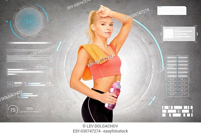 sport, fitness and people - tired sporty woman with water bottle and towel over gray concrete background