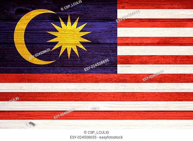 Malaysia Flag painted on old wood plank background