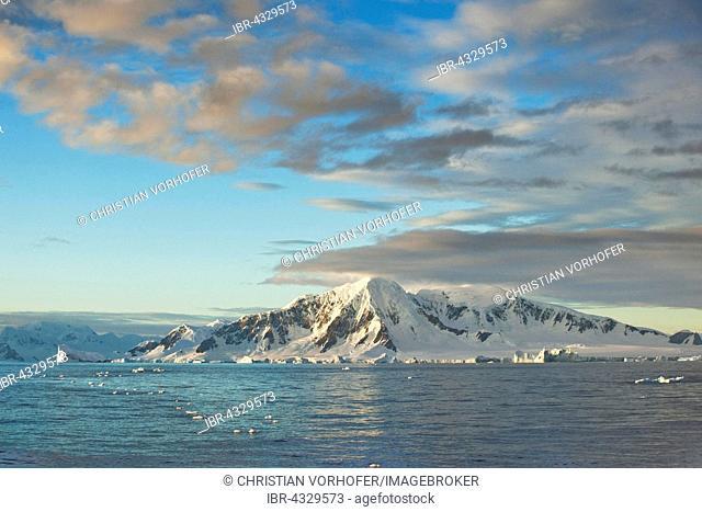 Snowy rocks in morning light, cloudy atmosphere, Antarctic Peninsula, Antarctica
