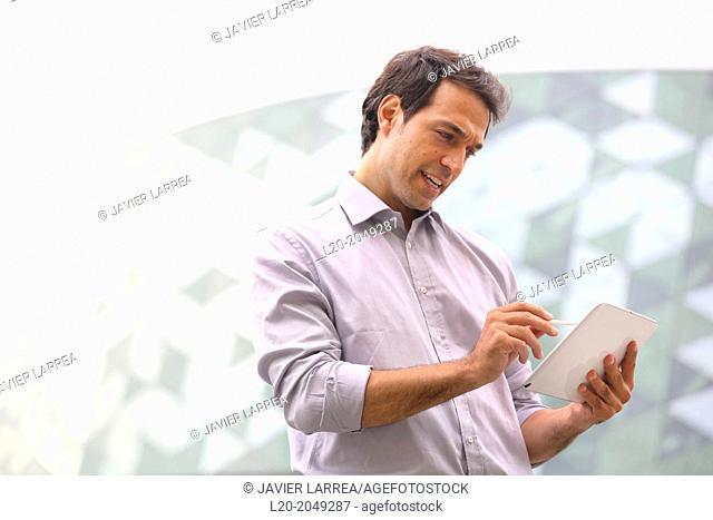 Business man with tablet in business center. San Sebastian Technology Park. Donostia. Gipuzkoa. Basque Country. Spain