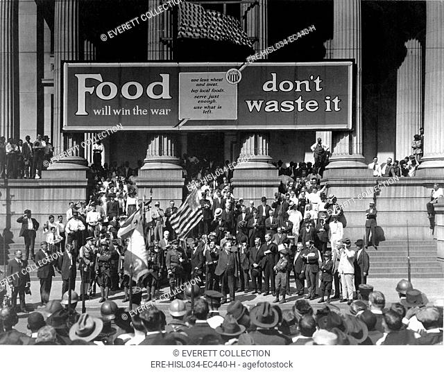 'Food Will Win The War. Don't Waste It', exhorts the banner at a rally for the Fourth Liberty Loan Campaign during World War I
