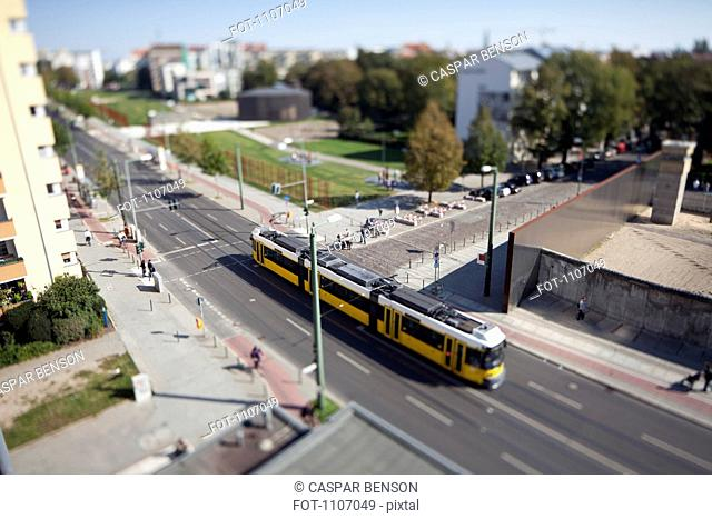A street scene with a tram, tilt-shift, Berlin, Germany