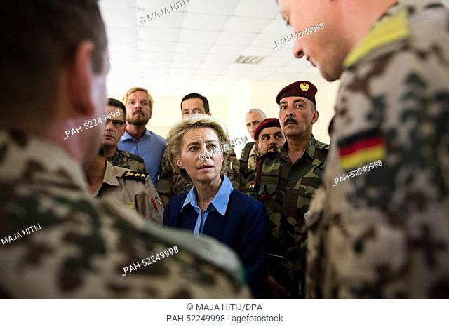 German Minister of Defence Ursula von der Leyen (CDU, C) talks to soldiers of the German Armed Forces and to members of the Kurdish military in a barracks at...