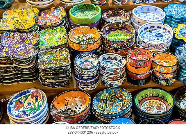 Collection of Traditional Turkish ceramic bowls and plates with painted landmarks on sale at Grand Bazaar in Istanbul, Turkey