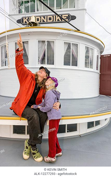 Mother and daughter sit outside on the deck of the SS Klondike, Whitehorse, Yukon Territory, Canada, Summer