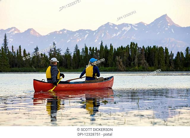 A Couple Canoeing On Stone Step Lake; Homer, Alaska, United States Of America