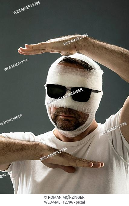 Man with gauze bandage, beauty craze