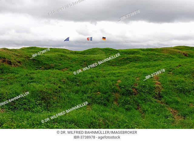 German, French and European flags flying over Fort Douaumont, a French fortress from the First World War, Verdun, Meuse departement, Lorraine region, France
