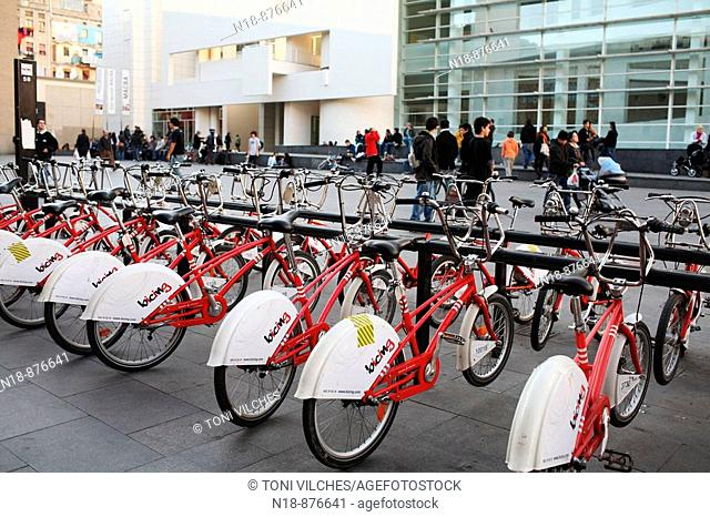 'Bicing' (community bicycle program) in front of MACBA Museum of Contemporary Art of Barcelona, Barcelona. Catalonia, Spain