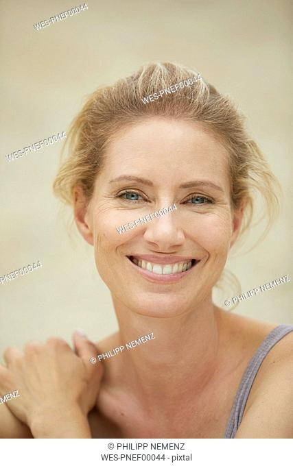 Portrait of laughing blond woman on the beach
