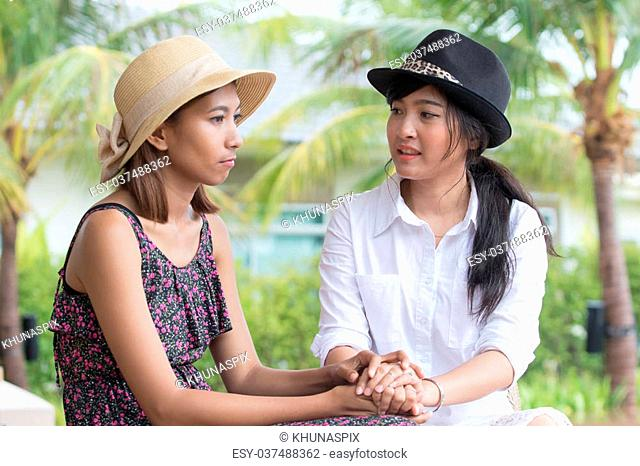 portrait of young asian woman friends talking to consult seriously problem and cheer up to fight a trouble