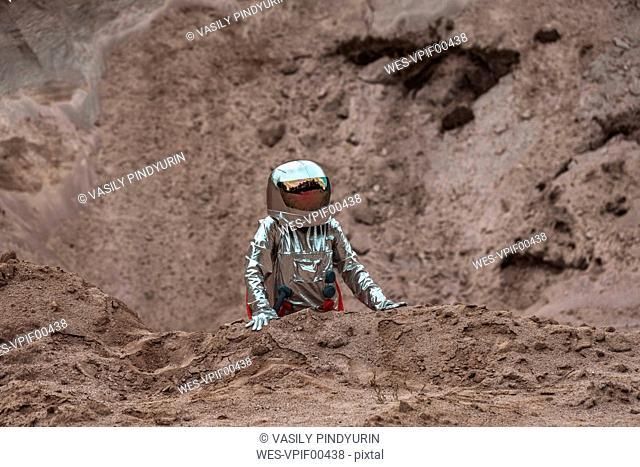 Spaceman exploring nameless planet