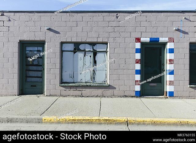 Entrance of abandoned barber shop