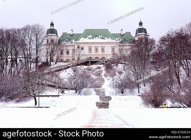 Winter in Ujazdowski park, Baroque-Neoclassical Ujazdow Castle - Zamek Ujazdowski - in historic Ujazdow district between Ujazdow Park - Park Ujazdowski and...