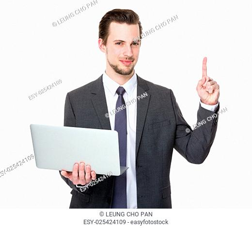 Businessman hold with laptop and finger point up