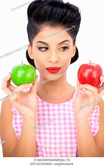 Pensive black hair model holding apples