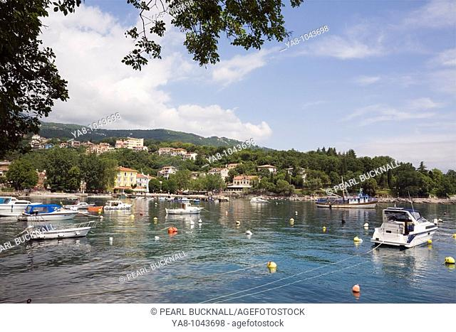 Ika Istria Croatia Europe  Moored boats in small fishing port and harbour for seaside village on Lungomare walkway on Opatija Riviera on Kvarner Gulf coast