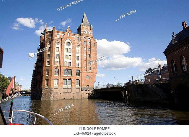 View from the bow of a ship at a brick-lined building of the Speicherstadt, Hamburg, Germany
