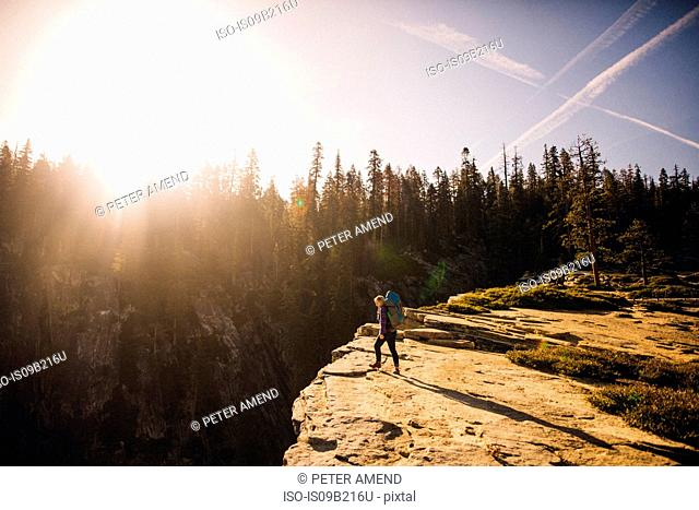Woman hiking on top of mountain, Yosemite National Park, California, USA