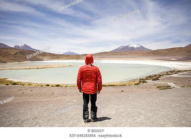 Young man at Laguna Hedionda at Eduardo Avaroa Andean Fauna National Reserve in Bolivia