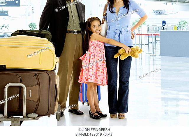 Multi-generational Asian family posing in airport