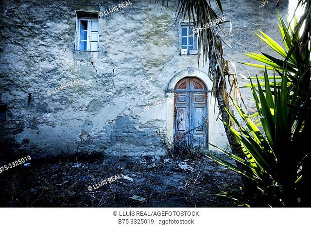 Facade of an abandoned village house at dusk. Santo- Pietro-de Tenda, Corsica, France, Europe