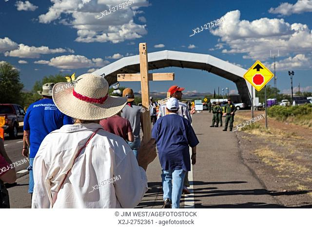 Tubac, Arizona - 9 October 2016 - Immigration reform activists march through the Border Patrol checkpoint on Interstate 19