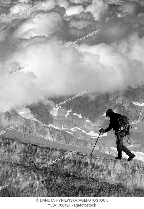 one man climbing in French Alps, Chamonix region, close to Aiguille du Midi, close to Mt Blanc, France, Europe
