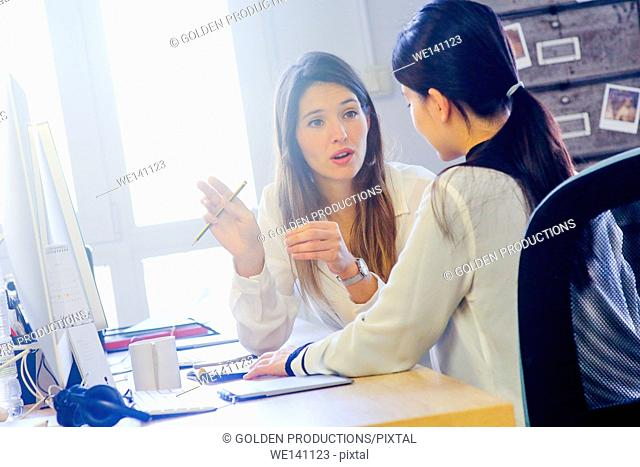 Young executives working in office. Advertising agency