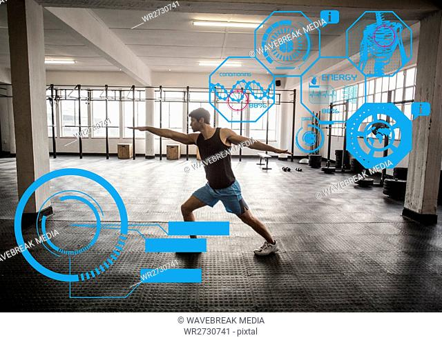 Fit man exercising in gym with futuristic interface