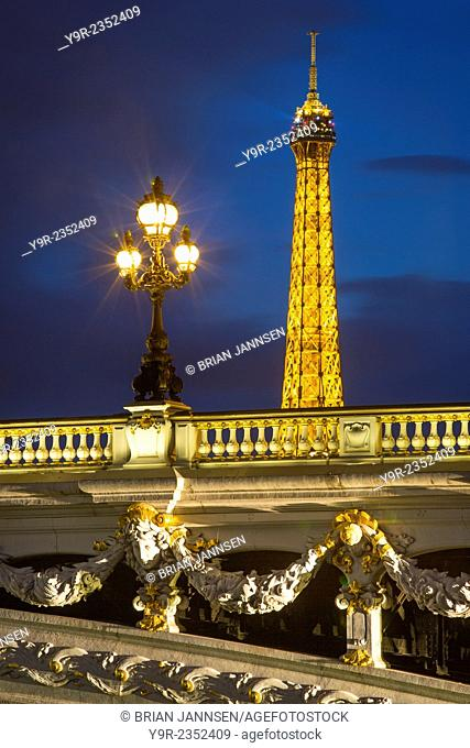 Ornate Pont Alexandre III with the Eiffel Tower looming beyond, Paris France