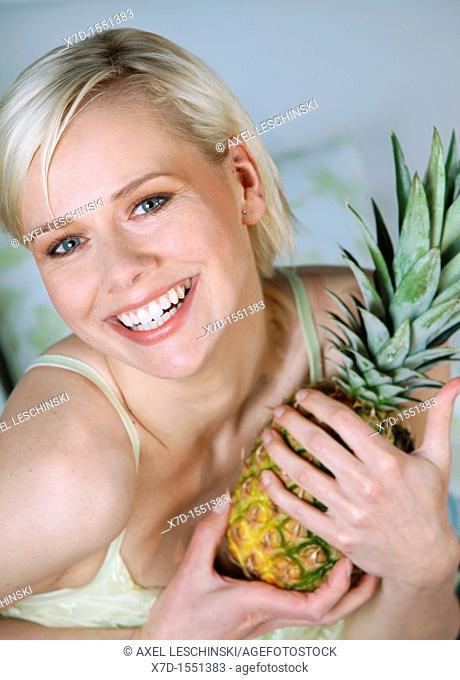 woman eating pineapple