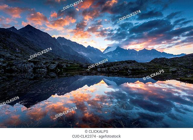 Sunrise from one of the many lakes near the Mandrone refuge, Genova valley, Adamello Brenta natural park, Trentino-Alto Adige, Italy