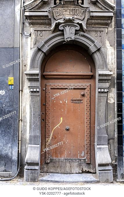Antwerp, Beligium. Godshuis Lantschot. Historical or Retro designed door and entrance inside a building's facade