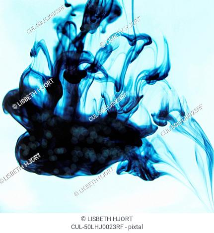 Blue ink swirling in liquid