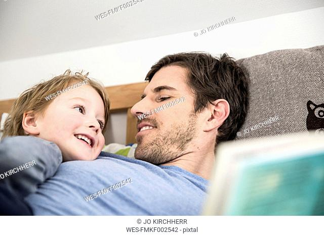 Father and son looking at each other, smiling