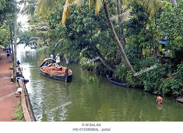 COUNTRY BOAT TRANSPORTING MATERIALS IN KUTTANAD, ALAPPUZHA