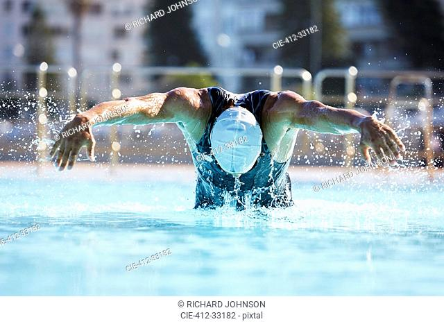 Male swimmer athlete butterfly stroke swimming swimming pool