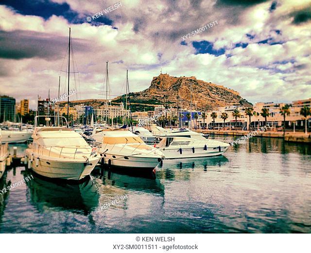 Alicante, Alicante Province, Costa Blanca, Spain. View across the harbour to the city and Santa Barbara Castle