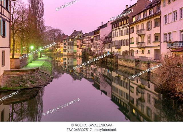 Traditional Alsatian half-timbered houses with mirror reflections, Petite France in the morning, Strasbourg, Alsace, France
