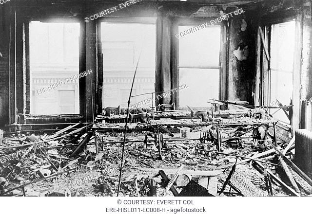 Triangle Shirtwaist Factory interior, with destroyed sewing machines, gutted by a fire that killed 146 on March 15, 1911