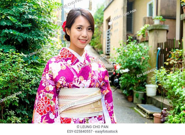 Young woman with kimono dress on street