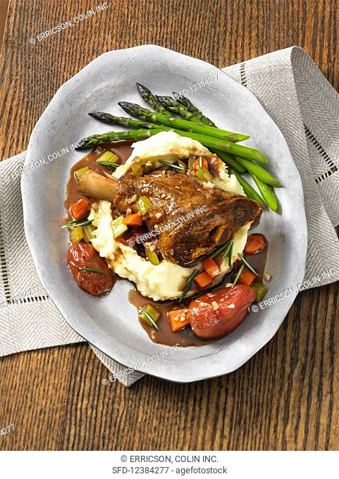 Braised lamb shanks with mashed potato and asparagus