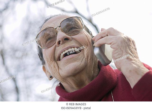 Portrait of senior woman on the phone