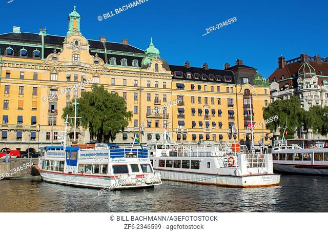 Stockholm Sweden beautiful city downtown center skyline from water with boats and buildings from cruise boat