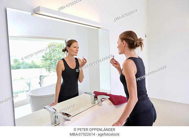 young woman in front of mirror in the bathroom