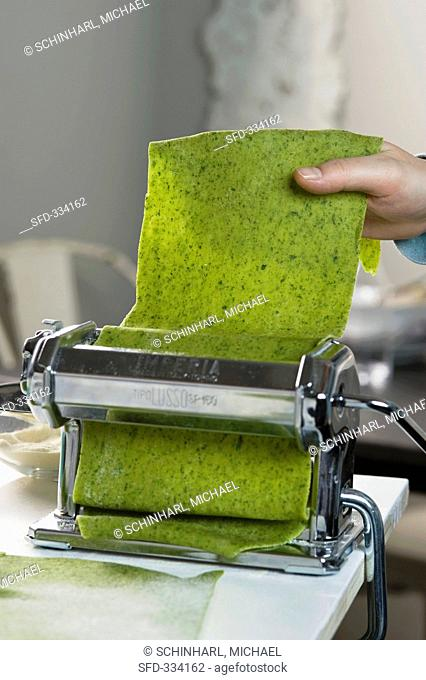 A pasta machine and dough for parsley ravioli