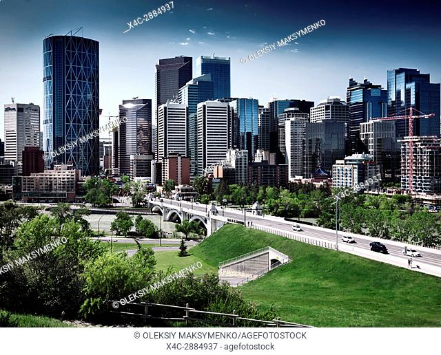 Calgary city downtown beautiful skyline with Centre Street Bridge over Bow river artistic scenery with dramatic colors. Calgary, Alberta, Canada 2017