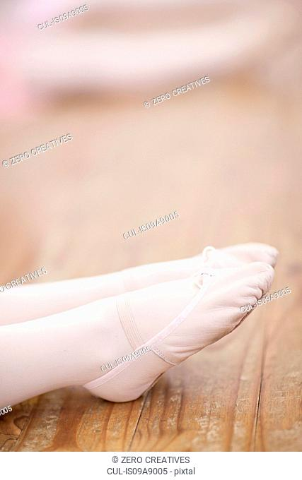 Close up of young ballerinas feet pointing