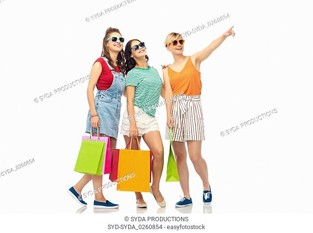 happy female friends with shopping bags